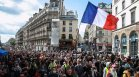 Хиляди на протест във Франция заради Ковид мерките, има ранени полицаи